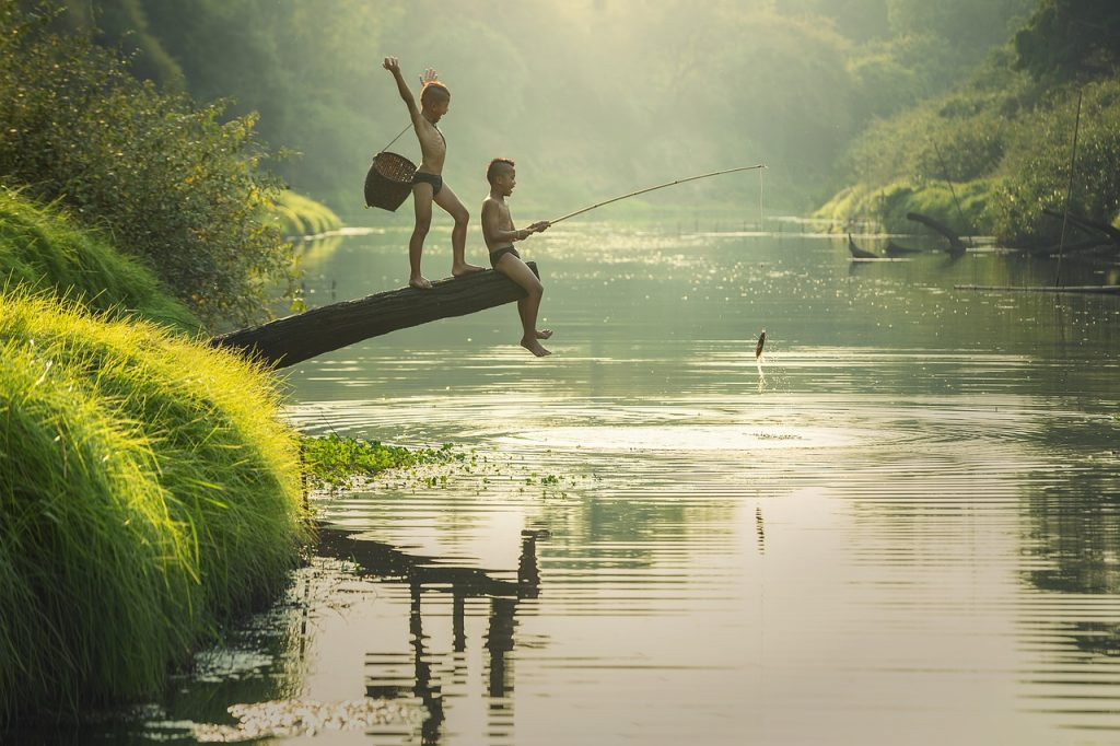 image of young boys fishing